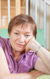 Thoughtful mature woman with sad face Royalty Free Stock Photo