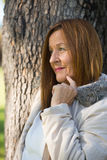Thoughtful Mature woman winter jackte outdoor Stock Photography