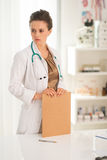 Thoughtful medical doctor woman with clipboard Stock Photo