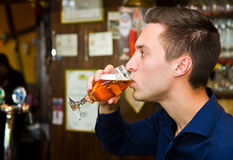 Thoughtful men drinking beer at the pub Stock Images
