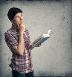 Thoughtful mid adult man with book Stock Photography