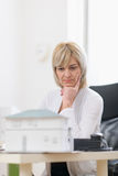 Thoughtful middle age architect woman at work Royalty Free Stock Image