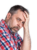 Thoughtful middle age man with hand near the face Stock Photo