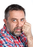 Thoughtful middle age man with hand near the face Royalty Free Stock Photo