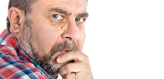 Thoughtful middle age man with hand near the face Stock Images
