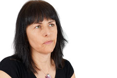 Thoughtful middle age woman. Thoughtful or wondering middle age woman Stock Photo