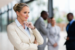 Thoughtful middle aged businesswoman Stock Image