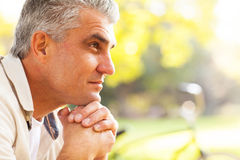 Thoughtful middle aged man. Portrait of thoughtful middle aged man outdoors Royalty Free Stock Photography