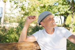 Thoughtful middle-aged man relaxing and smoking Royalty Free Stock Photography