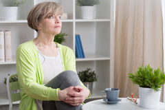 Thoughtful middle aged woman Royalty Free Stock Image