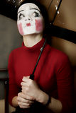Thoughtful mime with an umbrella Stock Photos