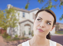 Thoughtful Mixed Race Woman In Front of House Stock Photo
