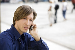 Thoughtful with mobile in hand Royalty Free Stock Photo