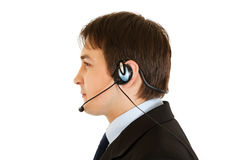 Thoughtful  modern businessman with headset Royalty Free Stock Photography