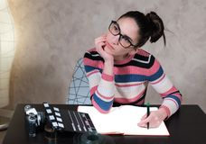 Thoughtful about movie screenplay writing. Thoughtful creative person while writing movie screenplay Stock Image