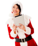 Thoughtful Mrs Claus with a tablet Stock Photography