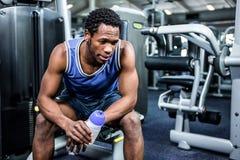 Thoughtful muscular man taking a break Stock Image