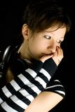 Thoughtful music lover. Attractive young girl with headphones Stock Images
