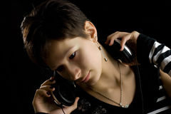 Thoughtful music lover2. Attractive young girl listening to the music Stock Photography