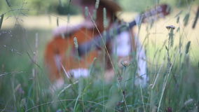 Thoughtful Musician Among The Tall Grass stock video