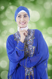 Thoughtful muslim woman with bokeh background Stock Images