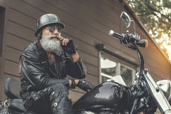 Thoughtful old man going to have ride stock photo