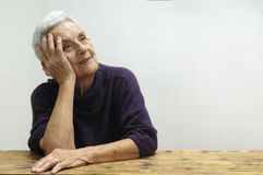 Thoughtful old woman happy, royalty free stock photography