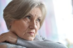 Thoughtful old woman home Stock Image
