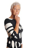 Thoughtful older woman with hand on chin royalty free stock photography