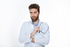 Thoughtful opthamologist at work Stock Image
