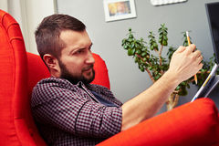 Thoughtful painter sitting on the red chair royalty free stock photo