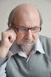 Thoughtful pensioner Stock Photography