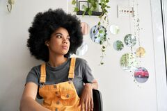 Free Thoughtful Pensive African Lady Looking Through Window Sitting At Home, In Cafe. Stock Photo - 195651740