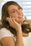 Thoughtful Phonecall. A young woman chatting on her mobile phone Stock Photo