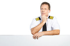 Thoughtful pilot. Royalty Free Stock Photo
