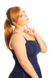 Thoughtful plus size woman Stock Image