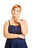 Thoughtful plus size woman Stock Photography