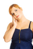 Thoughtful plus size woman Stock Image
