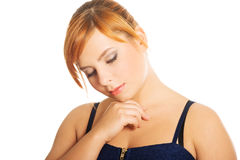 Thoughtful plus size woman Stock Photo