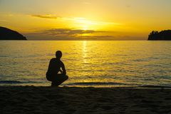 A thoughtful pose at sunset in New Zealand royalty free stock images