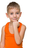 Thoughtful preschool boy. A portrait of a thoughtful preschool boy on the white background royalty free stock images
