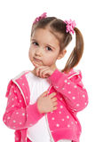 Thoughtful preschool girl in pink Stock Image