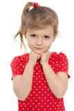 Thoughtful preschool girl on the white Stock Photography