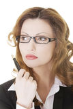 Thoughtful pretty businesswoman Royalty Free Stock Images
