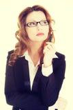 Thoughtful pretty businesswoman Stock Image