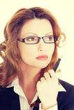 Thoughtful pretty businesswoman Stock Images