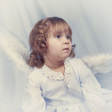 Thoughtful pretty girl with wings, christmas Royalty Free Stock Photo