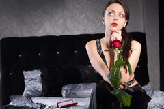 Thoughtful Pretty Woman with Red Rose Flower Royalty Free Stock Photo