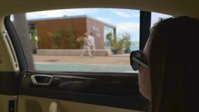 Thoughtful pretty woman in sunglasses traveling by car, relaxation, vacation. Stock footage stock footage