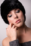Thoughtful Pretty Woman Wearing Furry Bonnet Stock Images